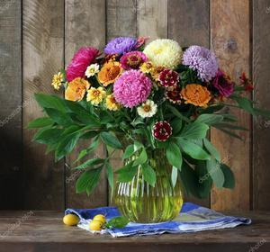 depositphotos_125771562-stock-photo-still-life-with-a-bouquet[1].jpg